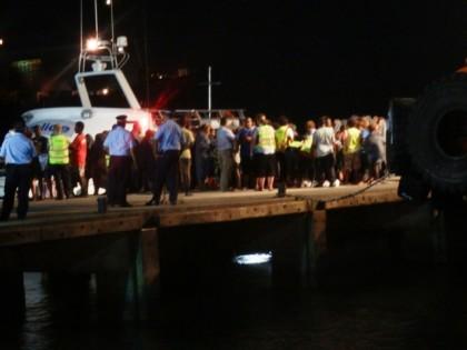 Survivors arriving at Point Cruz Wharf (10 pm last night).