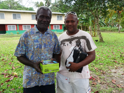 Left, a village elder from Panarui receiving his radio from Leni Dalavera