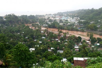 Residents near the Matanikau river as viewed from Skyline. Photo credit: SIBC.