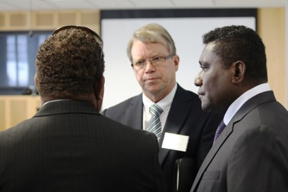 PM Lilo and his SSPM speaking to an NZ businessman during the recent trip. Photo: Douglas Marau.