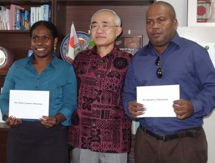 The two students and His Excellency the Janpanese Ambassador to Solomon Islands. Photo: SIBC.