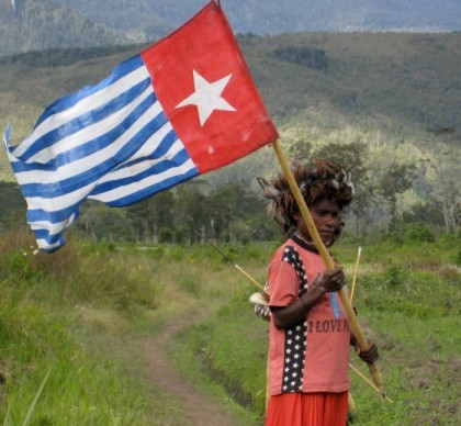 A woman waving the West Papuan flag. Photo: www.yorkvision.co.uk.
