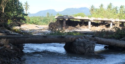 A bridge in West Guadalcanal totally cut off from the road on one side. Photo credit: SIBC.
