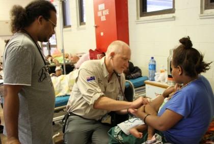 New Zealand Nurse Scott Cameron works with NRH doctor Kenton Sade to treat patients. Photo credit: Australian High Commission Honiara.