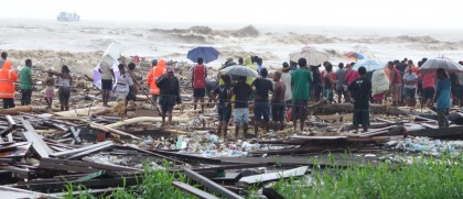 People along the shoreline,searching for missing people. Photo: SIBC.