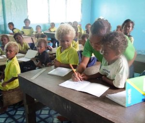 A primary school teacher of Kilusakwalo in class with her students. Photo credit: Solomon Times online.