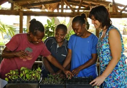 Australian volunteer Danielle Shallow (r) with SEB's Sharon Riasi, Serah Hori and Lawrencia Beata. Photo credit: Australian High Commission in Honiara.
