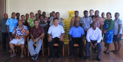 Foreign Minister Clay Forau with Ministry staff and goods at the background. Photo credit: Foreign Affairs.