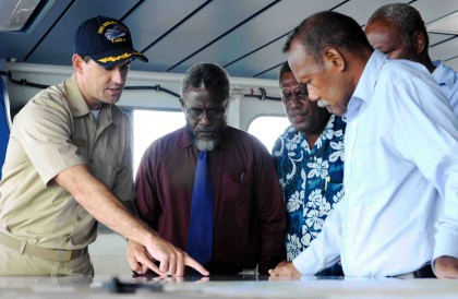 Richard Namo Irosaea, centre from left being shown a map of US Navy vessel. Photo credit: www.msc.navy.mil.