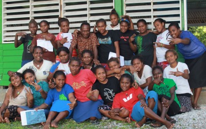 The female students with the seminar facilitator. Photo credit: SIBC.