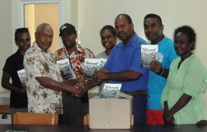 Members of the Writers Association handing over the books to a Curriculum staff. Photo credit: Anouk Ride.