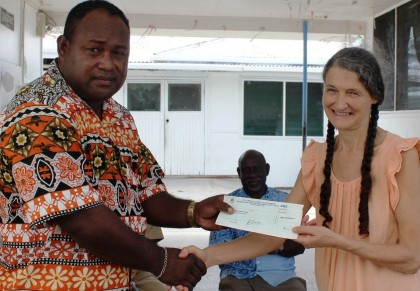 Acting Prime Minister Hon Manasseh Maelanga handover the cheque of 2 million dollar to Dr Jane Bottom. Photo credit: GCU.
