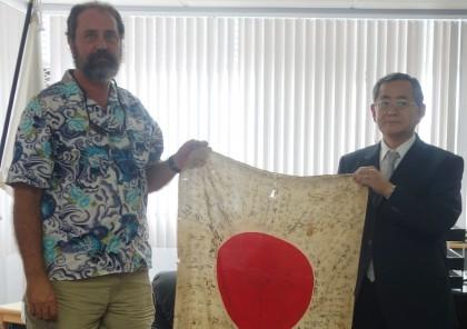 American Marine veteran Leonard Skinner and Japanese Ambassador Kenichi Kimiya with the flag. Photo credit: SIBC.