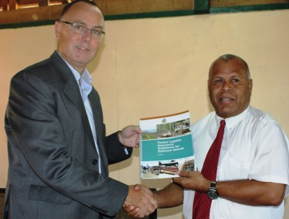 Australian High Commissioner to Solomon Islands Andrew Byrne handing over the Timber Guideline to Forestry PS Barnabas Anga. Photo credit: Rosalie Nongebatu.