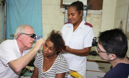 ENT Team Leader Brian Costello checking patient, Mary Tolosia's ear at the National Referral Hospital. Photo credit: Rosalie Nongebatu.