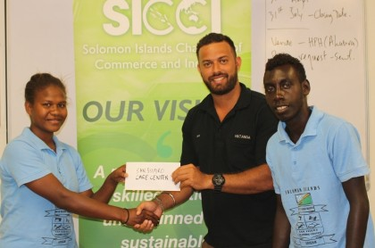 Handover of sponsorship cheque for San Isidoro Training Centre, 16 July 2014. Photo credit: SICCI.