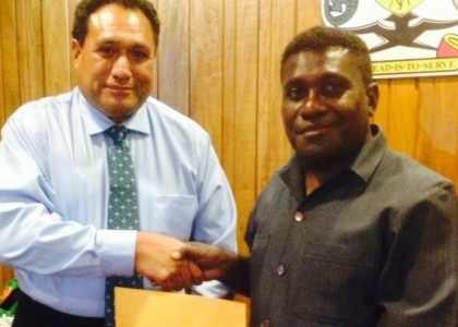 PM Lilo handing the letter of commitment to Dr Paunga. Photo credit: PMO.