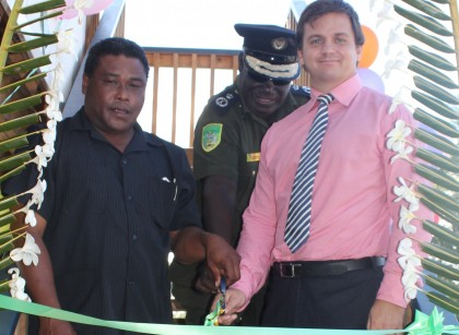 Police Minister Christopher Laore, CSSI Commissioner Haisoma and AHC's Robbin Perry cutting the ribbon at one of the staff houses at Tetere. Photo credit: Rosalie Nongebatu.