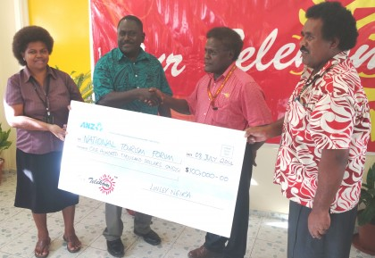 Our Telekom's Loely Ngira handing the cheque to Tourism Director Barney Sivoro. Photo credit: SIBC.