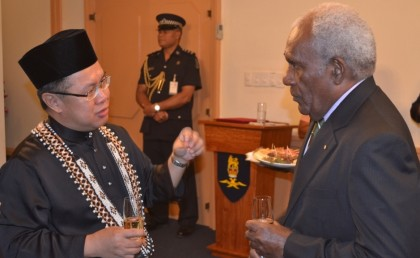 Ambassador Jilid Kuminding chats with Sir Frank during the presentation ceremony. Photo credit: GCU.
