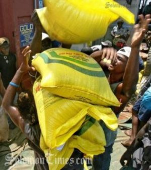 Bags of rice being loaded onto a vessel. Photo credit: Solomon Times online.
