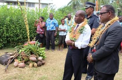 Premier Veke presenting a chupu to Acting Prime Minister Manasseh Maelanga. Photo credit; Douglas Marau.