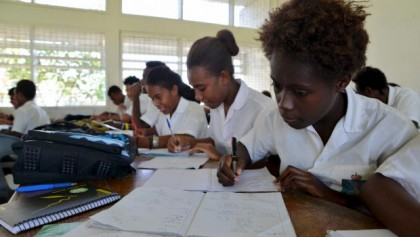 Students in class at KGVI school. Photo credit: SIBC.