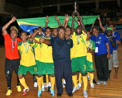 The Solomon Islands National Futsal team celebrating their win in 2009. Photo credit: Oceania Football.