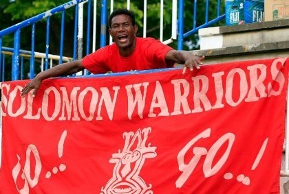 A fan with a Solomon Warriors banner. Photo credit: Facebook.
