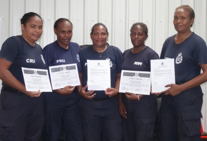 Female police members with their certificates after the POM training. Photo credit: SIBC.