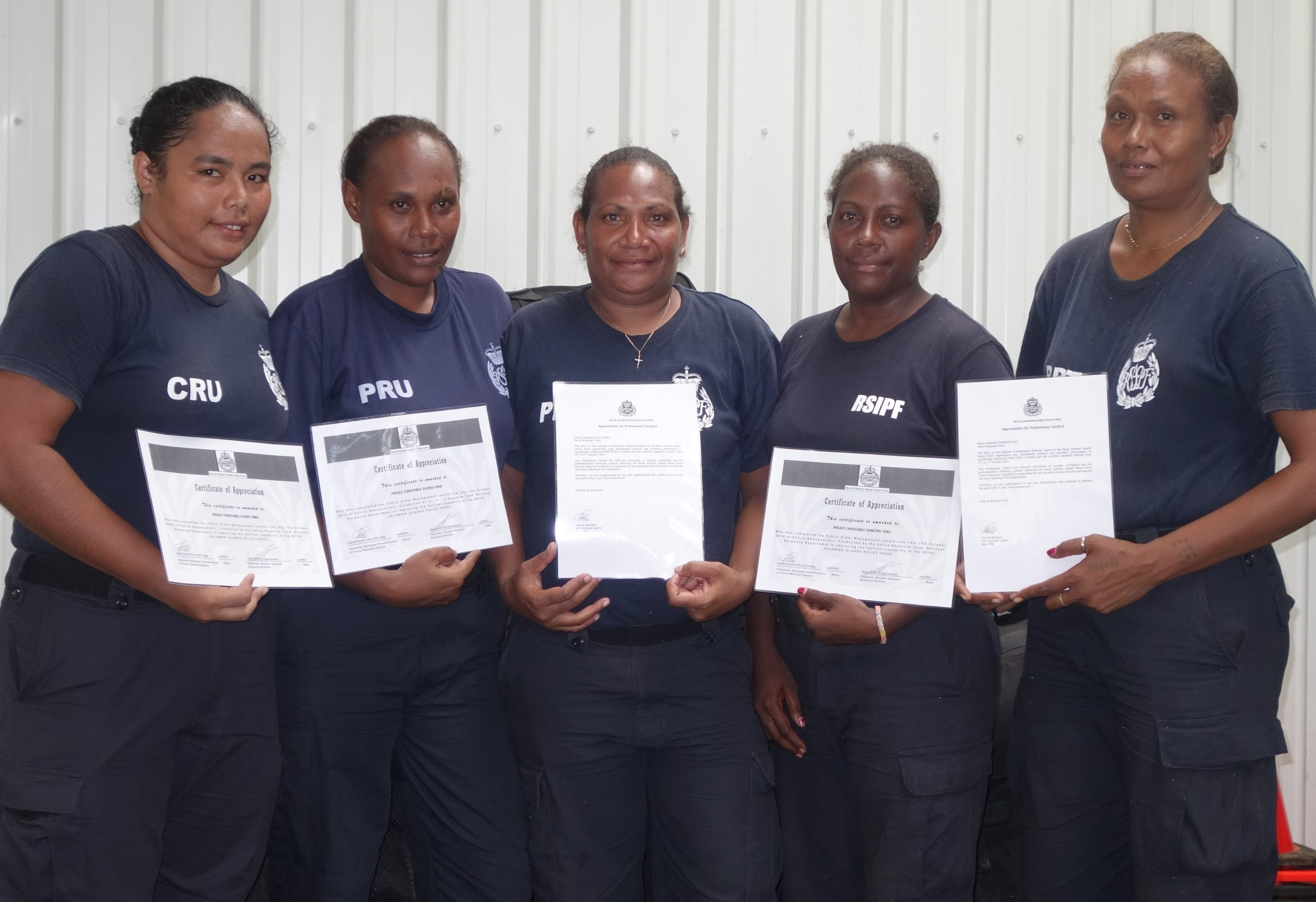 Female police members with their certificates after the POM training