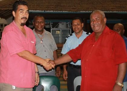 Bodo Dettke and Albert Fono shaking hands. Photo credit: SIBC.