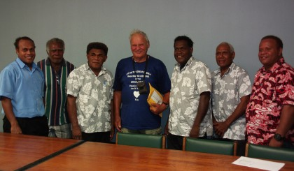Members of the organizing committee pausing for a photo with Brother George. Photo credit: SIBC.