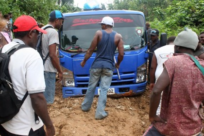 A truck got stuck in deep mud along one of the roads in Malaita Province. Photo credit: www.panoramio.com