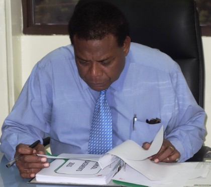 MEHRD Minister Dr Derek Sikua signing to release the Form Six placements. Photo credit: SIBC.