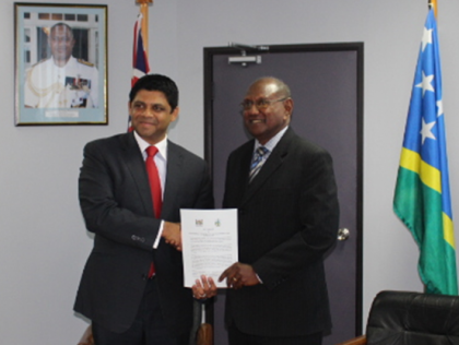 Solomon Islands Minister for Foreign Affairs and External Trade and Supervising Minister for Aviation Hon Milner Tozaka and Fiji's Minister for Aviation display the signed agreement. Photo credit: OPMC.