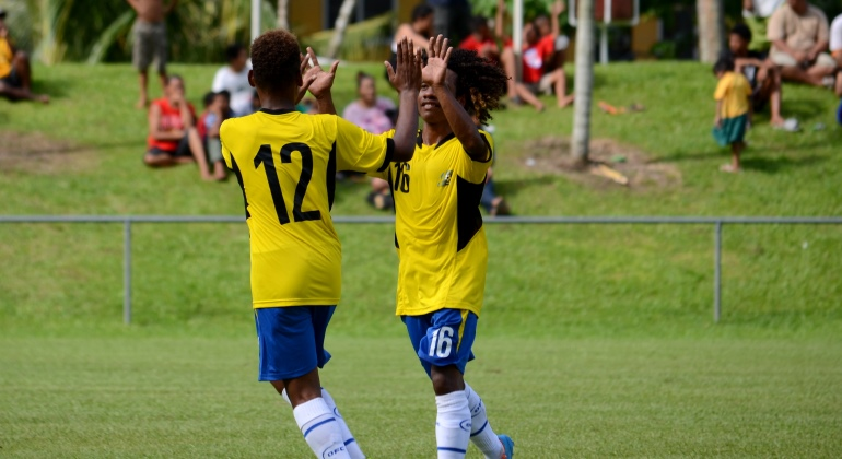 Solomon Islands players congratulate each other after