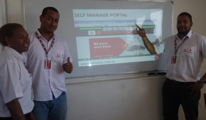 Bmobile Vodafone officers with the portal. Photo credit: SIBC.