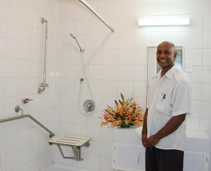Head Nurse John Richardson admiring the newly refurbished bathroom at the post-natal ward. Photo credit: Rosalie Nongebatu.