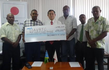 Japanese Ambassador Kenichi Kimiya (middle) flanked by members at the signing. Photo credit: SIBC.