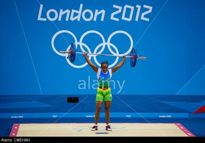 London, UK. 30th July, 2012. Tegu Wini Jenly (SOL) lifts 65kg in the Womens 58kg Group B Snatch event during the Weightlifting Competition on Day 3 of the London 2012 Olympic Games at ExCeL. Photo credit: www.alamy.com