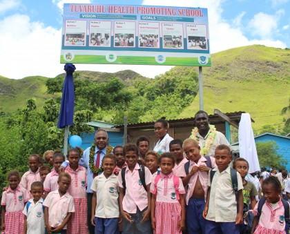 Mayor Alfrence Fatai (left) and HCC Chief Education Officer Wayne Koebule with the students in front of the billboard. Photo credit: HCC.