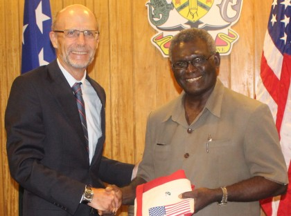 Prime Minister Manasseh Sogavare receiving a gift from PNG-based US Ambassador Walter North. Photo credit: OPMC.