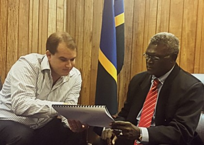 Significant findings: Axiom Chief Executive Officer, Mr Ryan Mount, left, shows Prime Minister Manasseh Sogavare the report on the new findings on high grade nickel deposits in Isabel. Photo credit: OPMC.