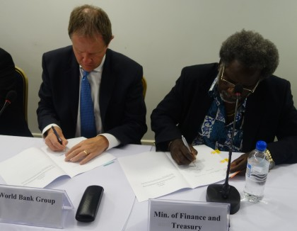 World Bank Country Director Pacific Franz-Drees Gross and Finance Minister Snyder Rini signing the RDP agreements. Photo credit: SIBC.