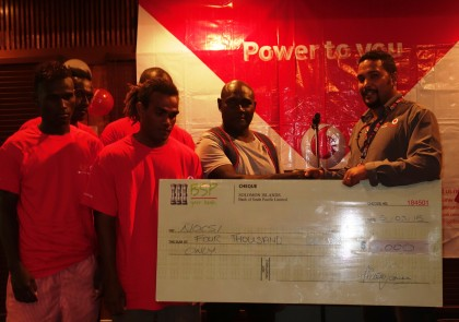 Bmobile Vodafone's Head of Sales Vivian Wickham with the cheque and members of the boxing team. Photo credit: SIBC.