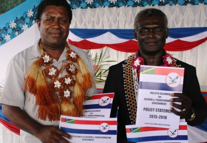 Premier Peter Ramohia and Prime Minister Sogavare with the policy documents. Photo credit: OPMC.