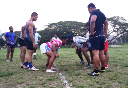 Illi Tabua (wearing cap) demonstrating scrummaging techniques during one of the sessions last year at the Panatina field. Photo credit: SIRUF.