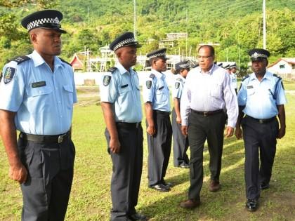 Masi Lomaloma inspects Buala police parade. Photo credit: RAMSI Public Affairs.