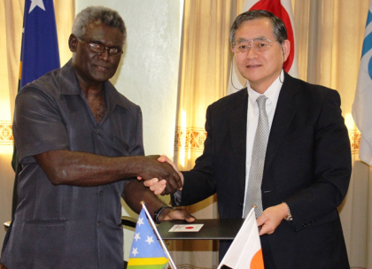 A handshake of friendship between Solomon Islands and Japan by PM Sogavare and Ambassador Kimiya after sealing the agreement for the Kukum Highway Project. Photo credit: OPMC.
